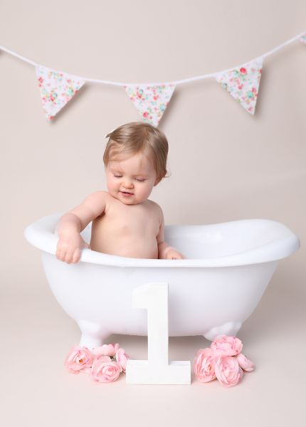 first birthday cake smash and splash photoshoot