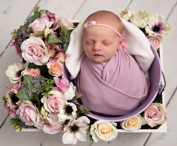 Flowers used in baby girl's photo at newborn photo shoot in Leeds
