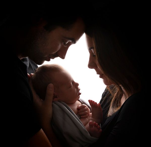 flattering family pose at newborn photography session