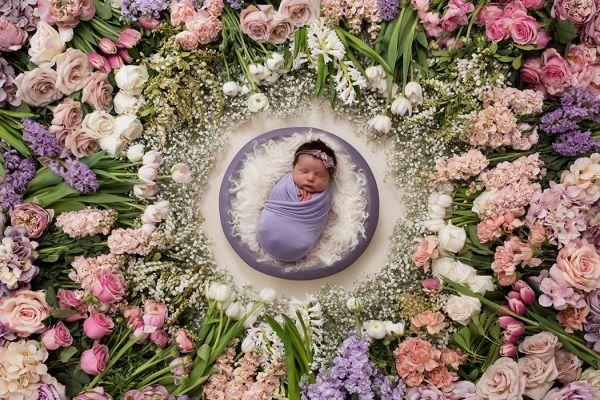 Newborn photography session using fresh flower digital backdrop