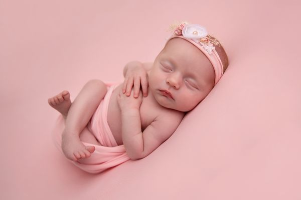 Sleeping newborn girl at photo shoot in Leeds studio