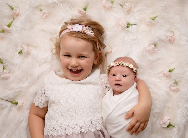 Sister sibling shot at newborn photography session