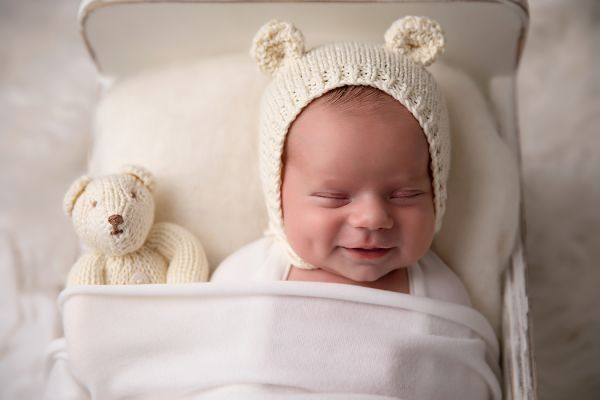 Smiling baby at newborn photography session in Leeds