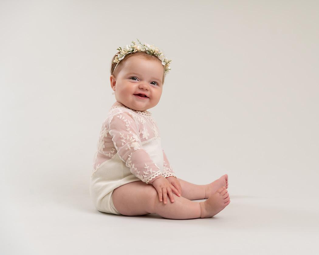 Baby girl cream backdrop sitter