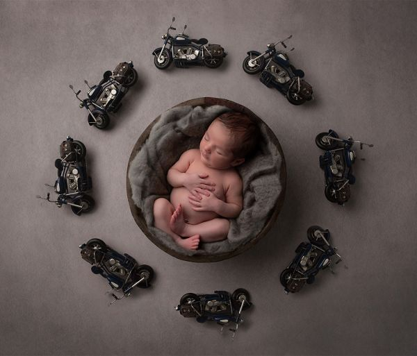 Newborn photoshoot using motorbike